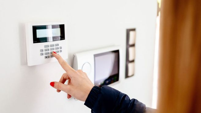 A woman using a digital door lock