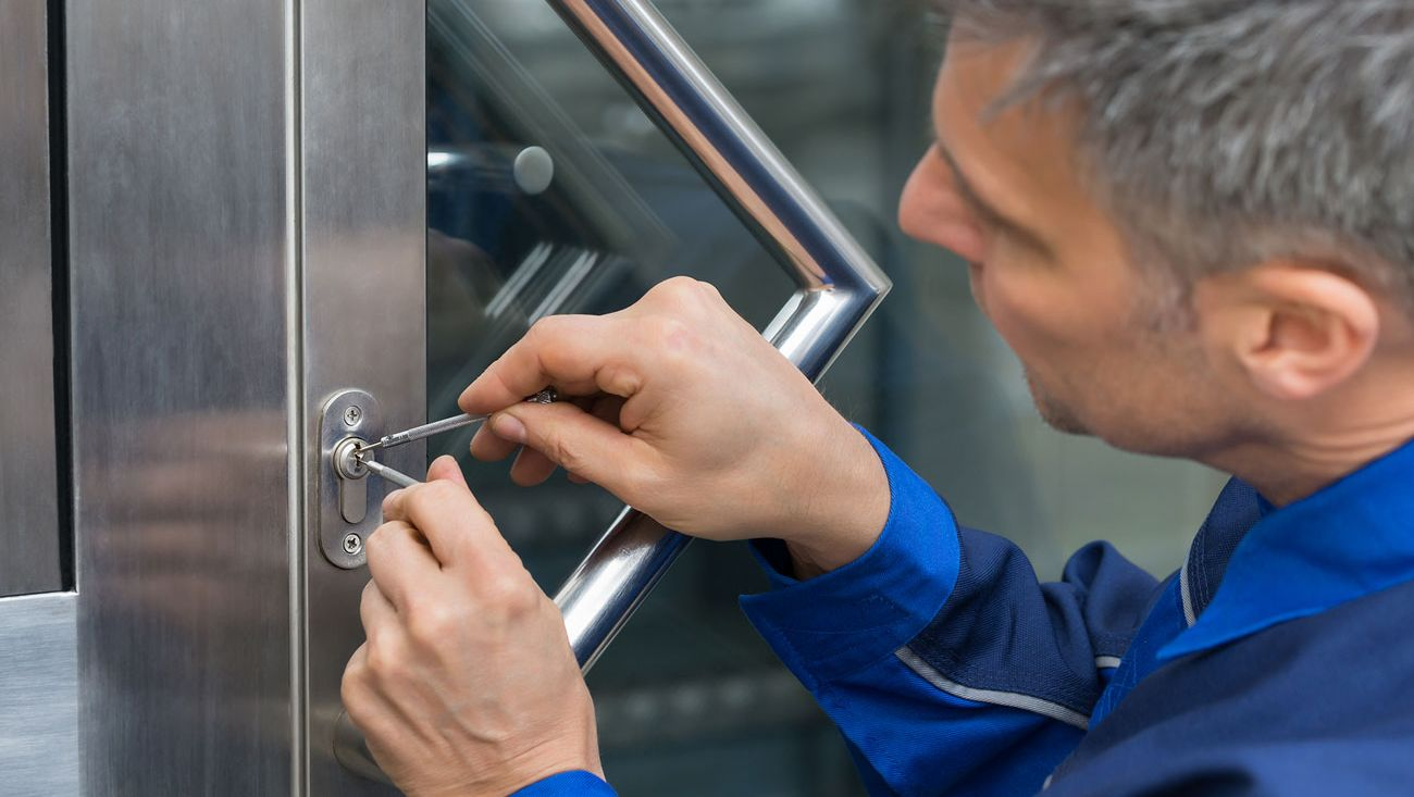 A locksmith picking a lock